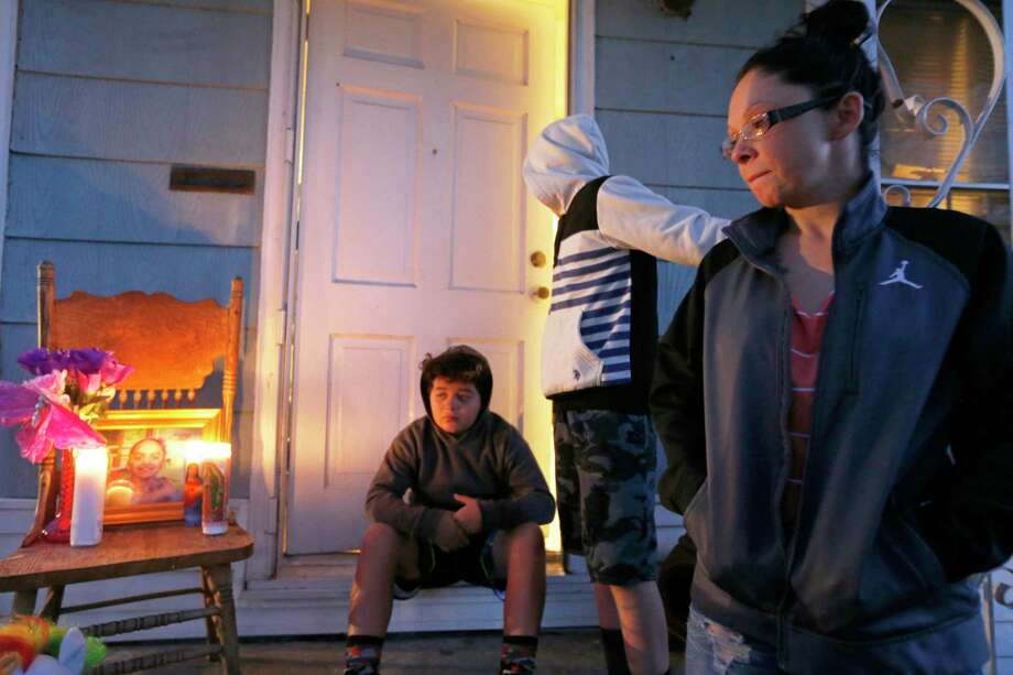 Jackie Vega talks about her daughter, Delilah Hernandez, 10, who was killed in a shooting, Thursday Nov. 23, 2017 at her home in the 100 block of Harwood Drive. Vega's sons Bishop Renaud,12, (center) and Malachi Renaud, 11, are pictured in background. Photo: Edward A. Ornelas, Staff / San Antonio Express-News / © 2017 San Antonio Express-News