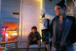 Jackie Vega talks about her daughter, Delilah Hernandez, 10, who was killed in a shooting, Thursday Nov. 23, 2017 at her home in the 100 block of Harwood Drive. Vega's sons Bishop Renaud,12, (center) and Malachi Renaud, 11, are pictured in background.