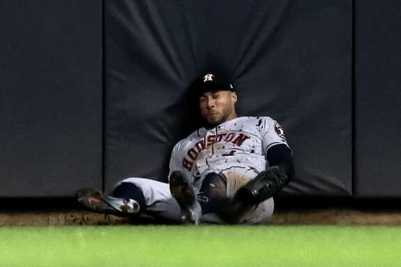 MILWAUKEE, WISCONSIN - SEPTEMBER 03:  George Springer #4 of the Houston Astros hits the ground after making a catch in the fifth inning against the Milwaukee Brewers at Miller Park on September 03, 2019 in Milwaukee, Wisconsin. (Photo by Dylan Buell/Getty Images)