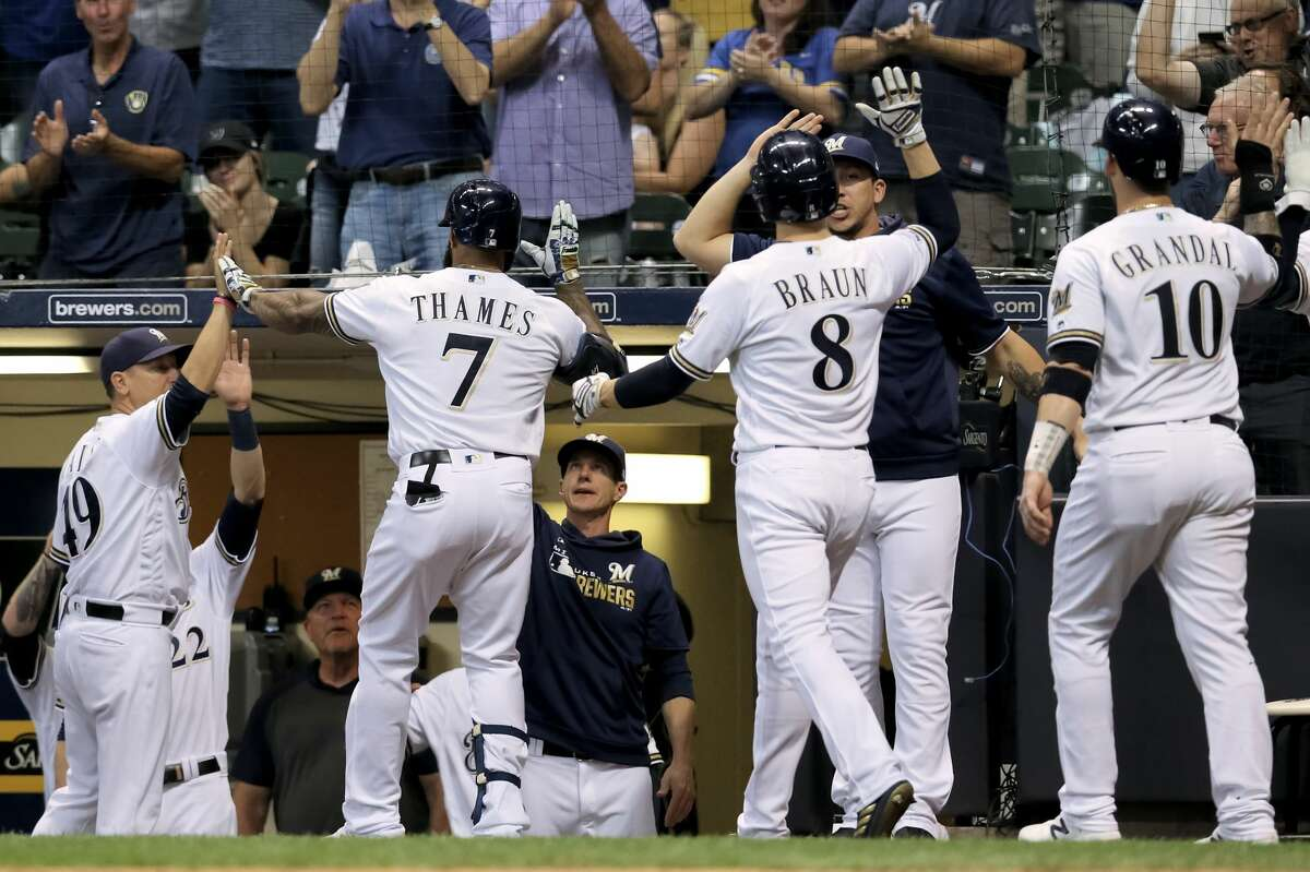 MILWAUKEE, WISCONSIN - SEPTEMBER 03: Eric Thames #7 of the Milwaukee Brewers celebrates with teammates after hitting a home run in the third inning against the Houston Astros at Miller Park on September 03, 2019 in Milwaukee, Wisconsin. (Photo by Dylan Buell/Getty Images)