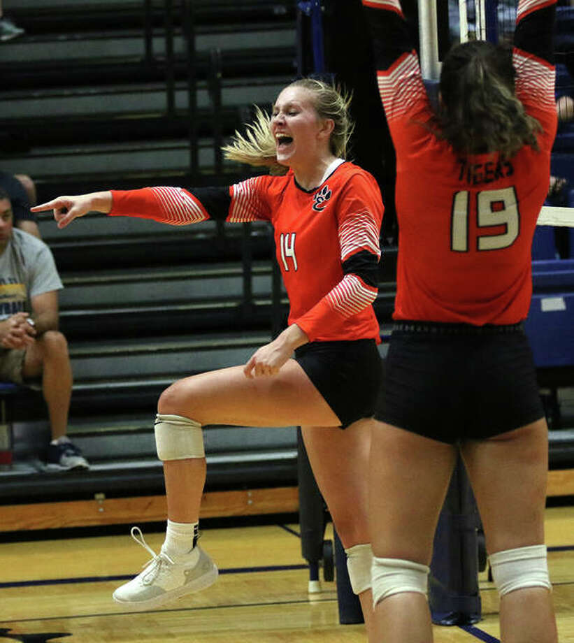 Edwardsville's Maddie Isringhausen (left) celebrates one of her career-high 14 kills along with teammate Rhianna Huebner during the third set Tuesday at Panther Dome in O'Fallon. Photo: Greg Shashack / The Telegraph