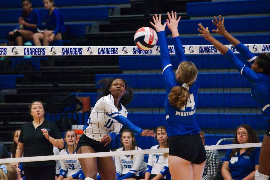 Clear Springs' Haley Moses (11) tries to hit a shot past Katy Taylor's Kennedy Willoughby (14) Tuesday, Sep. 3 at Clear Springs High School. Photo: Kirk Sides/Staff Photographer