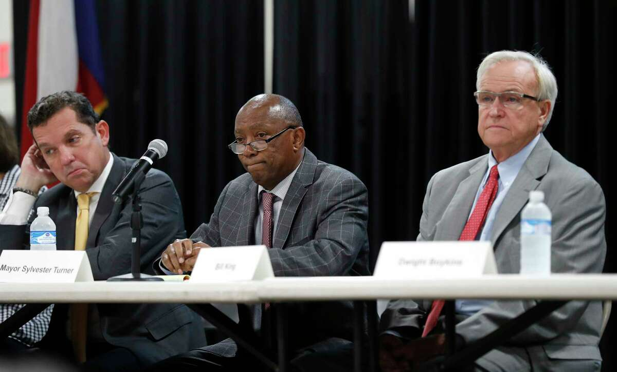 Tony Buzbee, Mayor Sylvester Turner, and Bill King sit together during a mayoral candidate forum for the 2019 election at the Garden Oaks Montessori Magnet school, September 3, 2019, in Houston. This is Mayor Sylvester Turner's first candidate forum. The forum is hosted by Super Neighborhood 12 and the Garden Oaks Civic Club.