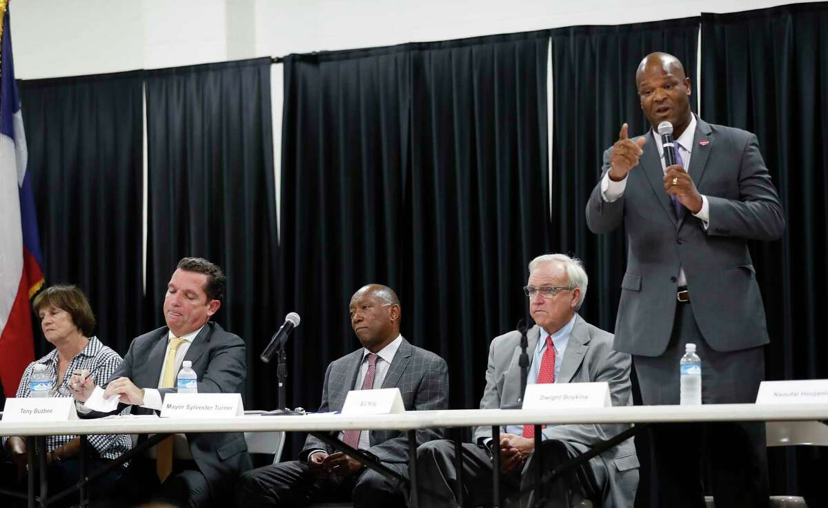 Tony Buzbee, Mayor Sylvester Turner, and Bill King, listen as Council Member Dwight Boykins speaks during a mayoral candidate forum for the 2019 election at the Garden Oaks Montessori Magnet school, September 3, 2019, in Houston. This is Mayor Sylvester Turner's first candidate forum. The forum is hosted by Super Neighborhood 12 and the Garden Oaks Civic Club.