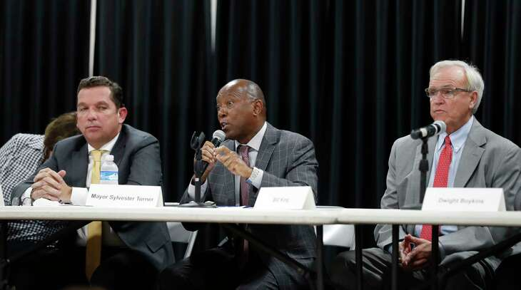 Mayor Sylvester Turner speaks as Tony Buzbee, left, and Bill King, right, listen during a mayoral candidate forum for the 2019 election at the Garden Oaks Montessori Magnet school, September 3, 2019, in Houston. This is Mayor Sylvester Turner's first candidate forum. The forum is hosted by Super Neighborhood 12 and the Garden Oaks Civic Club.