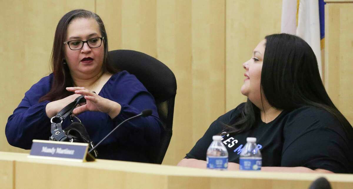 South San ISD secretary Shirley Ibarra Pena, left, chats with board member Mandy Martinez before the start of the special board meeting on Tuesday, Sept. 3, 2019. South San ISD trustees are expected to allow superintendent Alex Flores to resign.