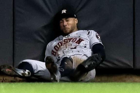 George Springer gave himself up while making a fifth-inning catch Tuesday night, hitting his head against the padded fence at Miller Park.