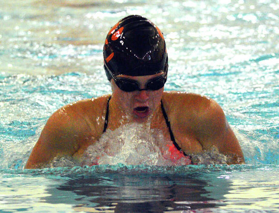 Edwardsville's Jordan Schlueter swims in the 100-yard breaststroke during Tuesday's dual meet against Champaign Central at Chuck Fruit Aquatic Center.
