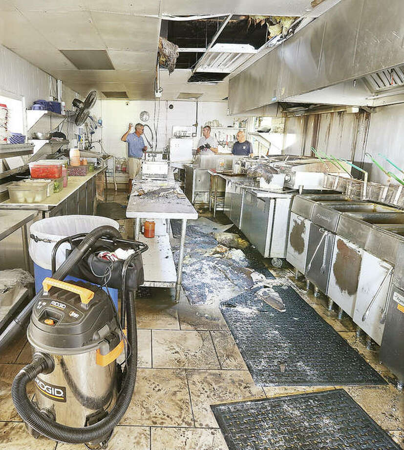 A hole in the ceiling shows where a fire was extinguished in the kitchen at The Loading Dock restaurant and bar in Grafton. The fire delayed the opening of the business for a few hours and repairs will still be needed.