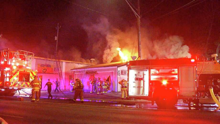A fire heavily damaged three businesses on the city's South Side early Wednesday morning, according to San Antonio Fire Department. Photo: Ken Branca