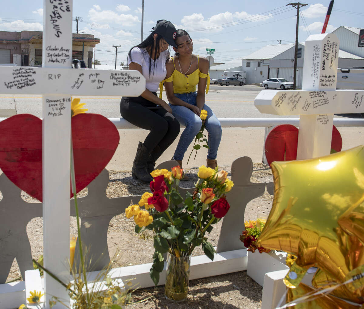 Kimberly Juarez and her mother, Lizeth Aguilar, mourn at white crosses, made by Greg Zanis from Illinois, that were placed on Tuesday, Sept. 3, 2019, at 2nd Street and Sam Houston Avenue in Odessa, Texas.Juarez's best friend, Leilah Hernandez, died in the mass shootings on Saturday, Aug. 31.