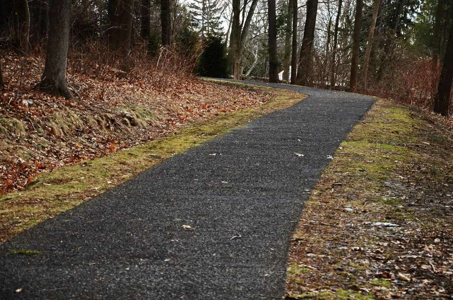 Another section of the Irwin Park trails in New Canaan, Conn., will soon be covered by Flexi-Pave. The material, pictured above, is a porous and non-cracking construction material composed in part from recycled tires. Photo: Nelson Oliveira / Nelson Oliveira / New Canaan News