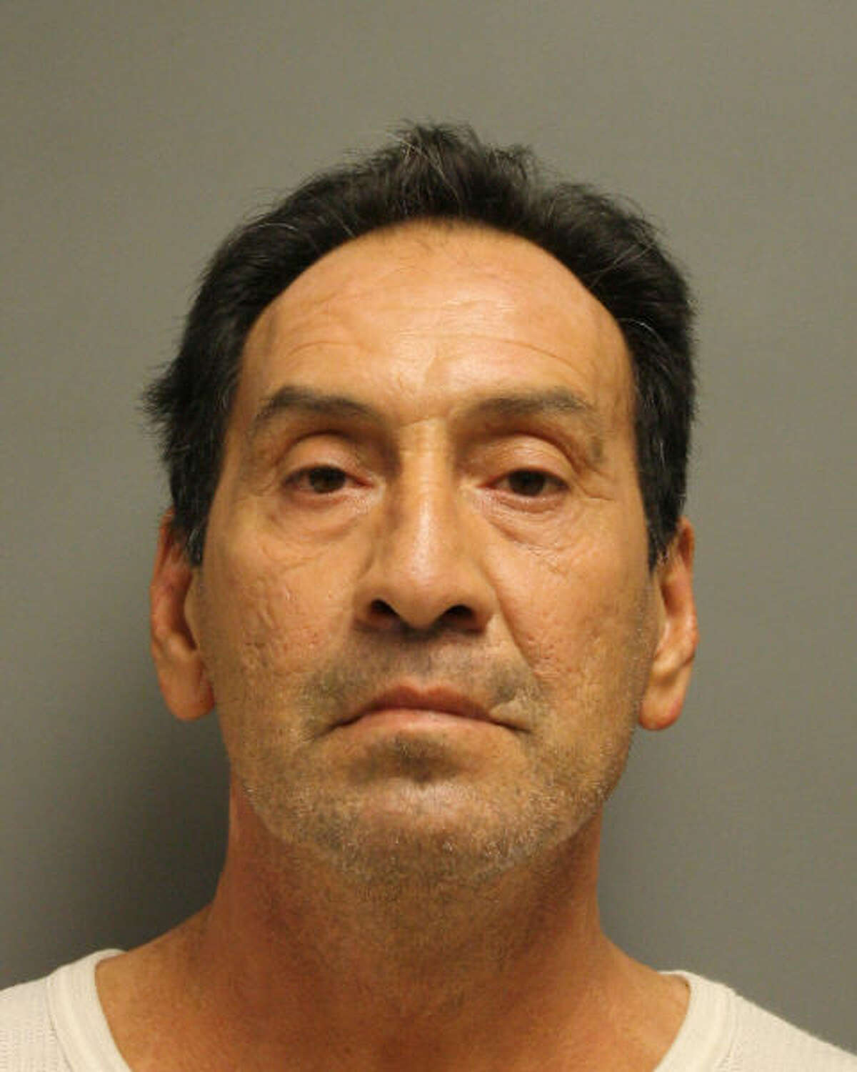John Richard Vasquez, 60, was charged with murder after allegedly crashing into a 55-year-old man on the side of the South Loop 610, killing him.