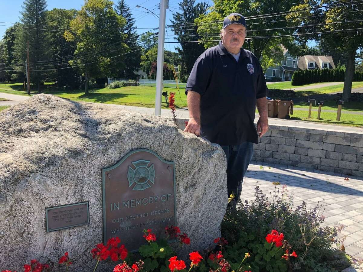 Huntington Fire Co. Capt. Donald Zak at the recently dedicated memorial garden in front of the Huntington Fire Co.
