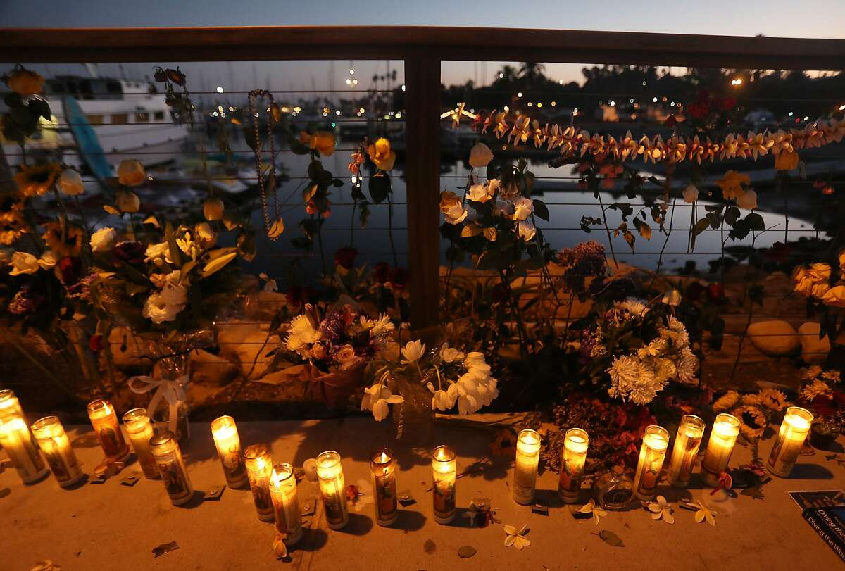 SANTA BARBARA, CALIFORNIA - SEPTEMBER 03: Candles are lit in Santa Barbara Harbor at a makeshift memorial for victims of the Conception boat fire on September 3, 2019 in Santa Barbara, California. Authorities believe none of the 34 people below deck survived after the commercial scuba diving ship caught fire and sank, while anchored near Santa Cruz Island, in the early morning hours of September 2. Five crew members survived. (Photo by Mario Tama/Getty Images)