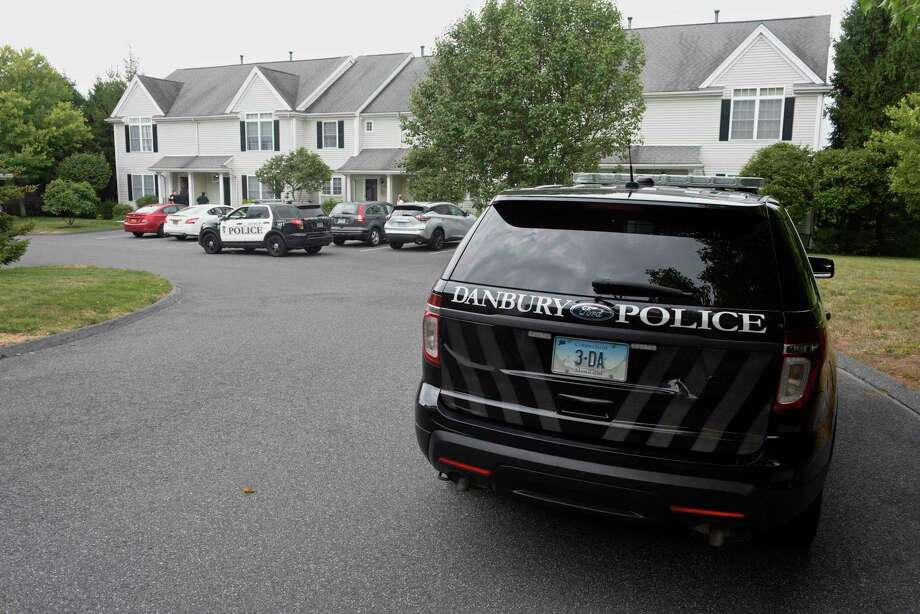 Police are investigating a homicide at the Sterling Woods Condominium Complex that occurred early this morning. One person is dead, police said, and investigators are currently seeking the person, or persons, involved. Officers stood outside the front door of a townhouse in The Maples section of the complex on Hancock Drive late Wednesday morning. Wednesday, September 4, 2019, in Danbury, Conn. Photo: H John Voorhees III / Hearst Connecticut Media / The News-Times