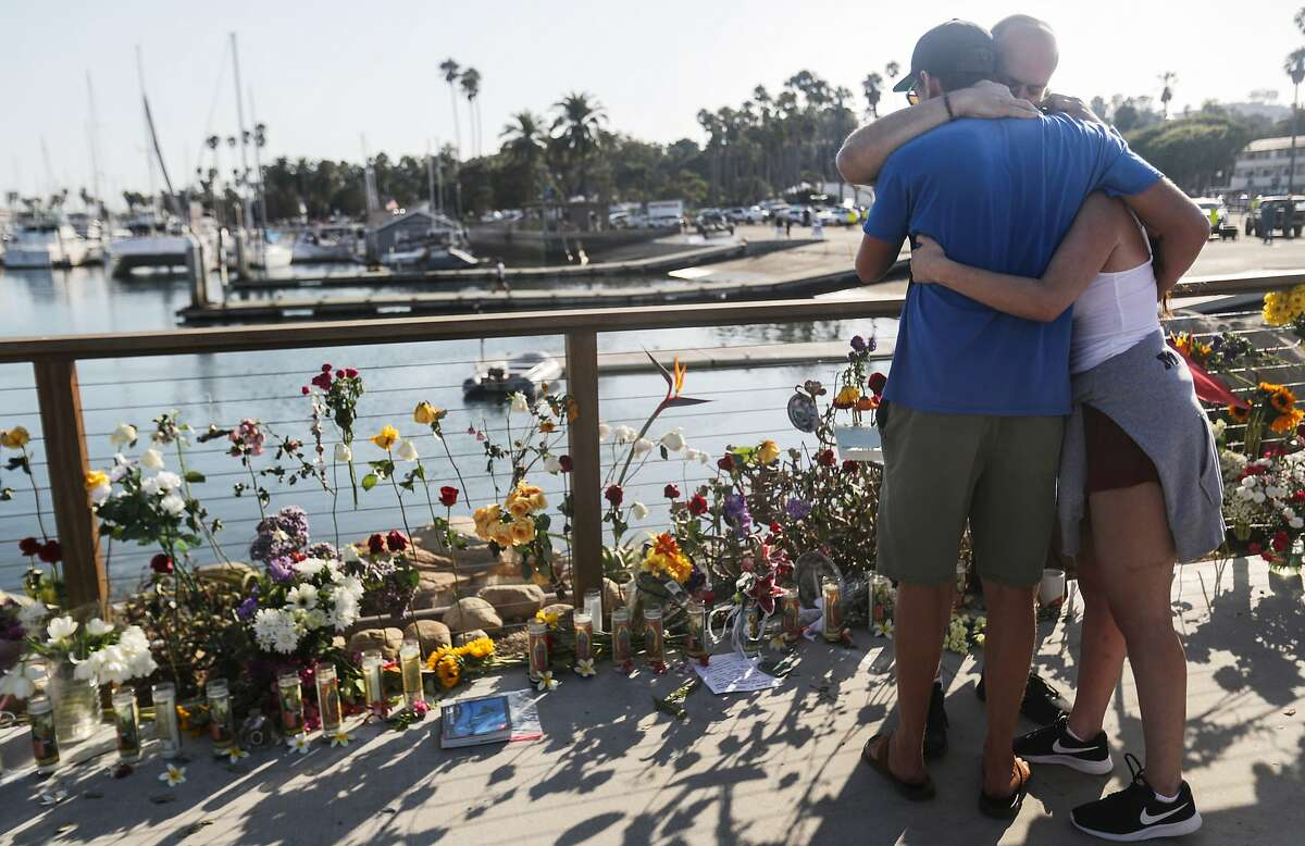 SANTA BARBARA, CALIFORNIA - SEPTEMBER 03: People embrace at Santa Barbara Harbor at a makeshift memorial for victims of the Conception boat fire on September 3, 2019 in Santa Barbara, California. Authorities have found 25 bodies thus far after the diving ship Conception caught fire and sank while anchored near Santa Cruz Island in the early morning hours of September 2. Five crew members survived. (Photo by Mario Tama/Getty Images) *** BESTPIX ***
