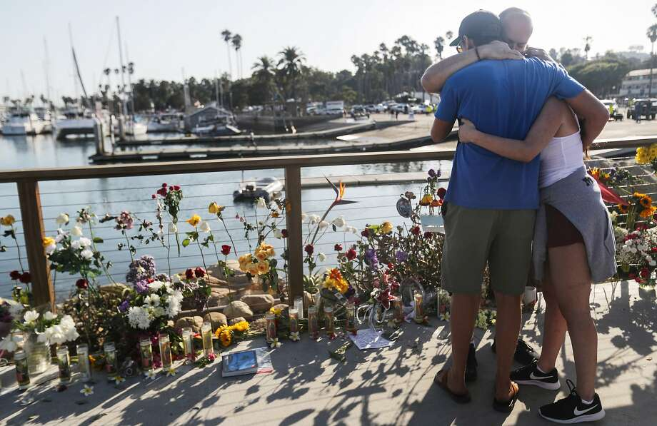 People embrace at Santa Barbara Harbor at a makeshift memorial for victims of the Conception boat fire on September 3, 2019 in Santa Barbara.  Photo: Mario Tama / Getty Images
