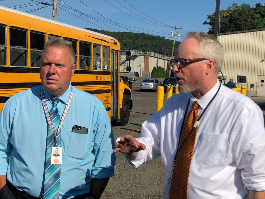 School Superintendent Dr. Chris Clouet, right, with school Finance Director Rick Belden outside the bus garage on Tuesday, Sept. 3, announced schools will open Wednesday, Sept. 4. Photo: Brian Gioiele / Hearst Connecticut Media / Connecticut Post