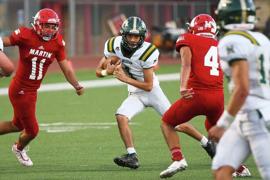 Nixon quarterback Austin Garcia ran for 78 yards on 10 carries in the Mustangs' win over crosstown rival Martin last Friday. Photo: Danny Zaragoza /Laredo Morning Times / Laredo Morning Times
