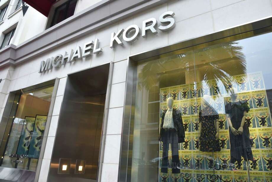 The Michael Kors store in Beverly Hills, California is seen on September 25, 2018. - Fashion house Michael Kors announced on September 25, 2018, it had agreed to buy Italian luxury giant Versace, signalling an intention to move deeper into the international big league after snapping up shoemaker to the stars Jimmy Choo in 2017. (Photo by Robyn Beck / AFP)ROBYN BECK/AFP/Getty Images Photo: ROBYN BECK / AFP/Getty Images / AFP or licensors