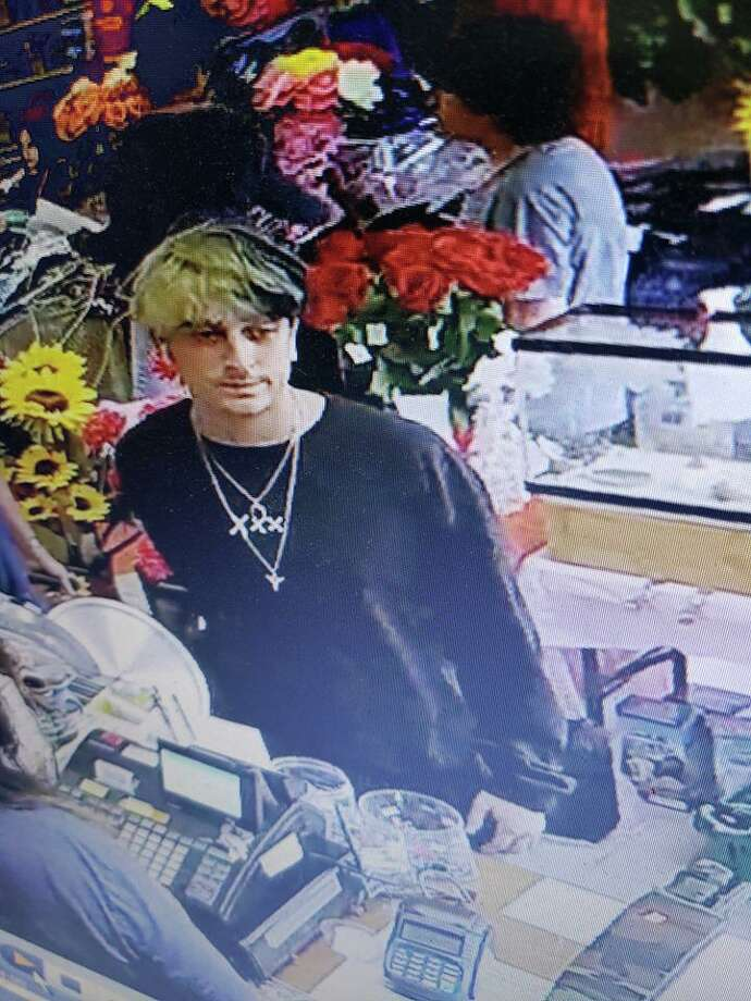 Derby Police are looking for help locating a shoplifting suspect captured in this surveillance footage. Photo: Derby Police Department / Contributed
