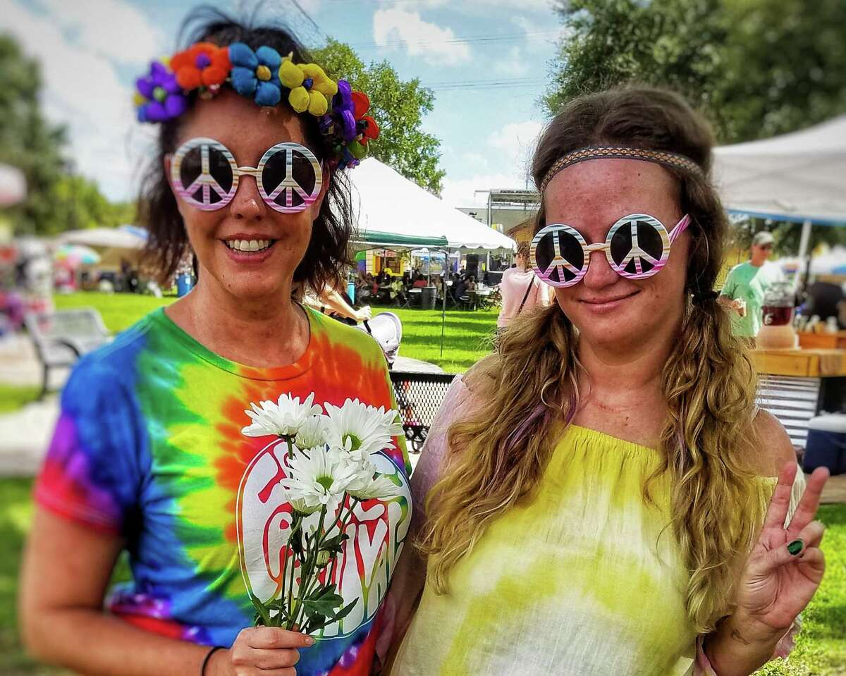 In this photo from before the pandemic, Tomball community events coordinator Denise Fiore and marketing assistant Larrissa Roberts pose for a photo during Tomball's inaugural GroovFest in 2018.