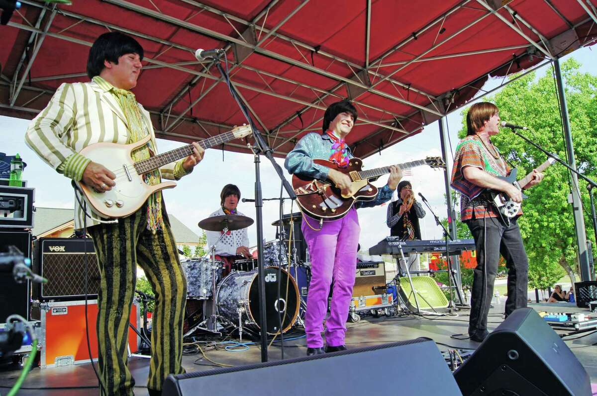 The Fab 5, a Beatles tribute band shown here during an event held before the pandemic, will perform during Tomball's virtual GroovFest.