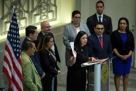 Rep. Ana Hernandez, standing with other members of the Texas House Democratic Caucus, speaks during a news conference to demand Gov. Greg Abbott to call a special session aimed at limiting gun violence on Wednesday, Sept. 4, 2019, in Houston.