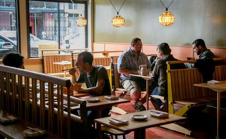 People have dinner at Chubby Noodle in San Francisco, Calif., on July 21st, 2015.