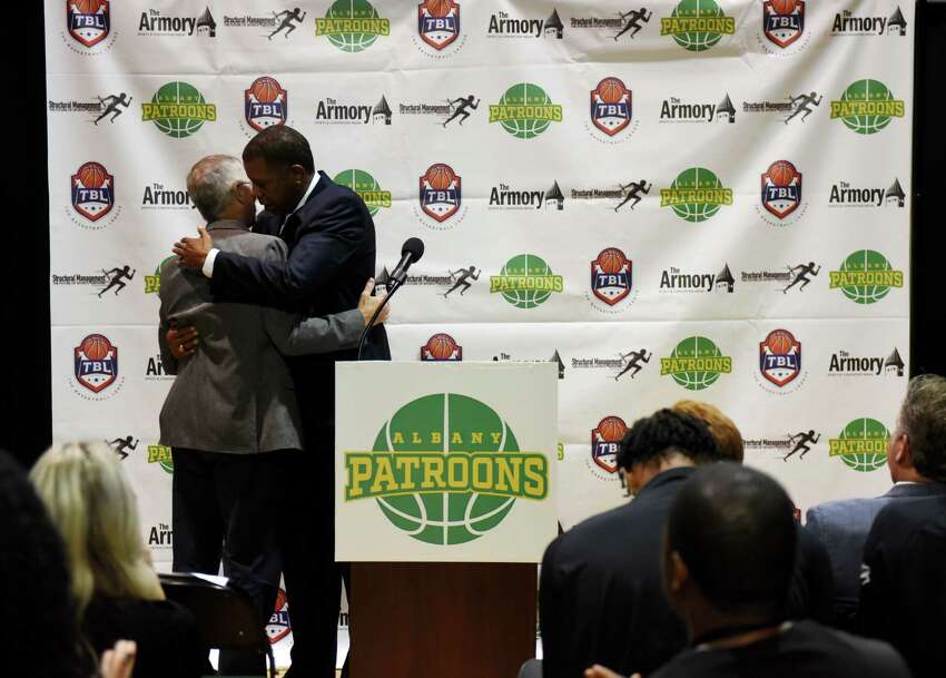 Albany Patroons new owner, Schenectady chiropractor Tim Maggs, left, is embraced by head coach Derrick Rowland during a media event to introduce Maggs as the new team owner on Wednesday, Sept. 4, 2019, at the Washington Avenue Armory in Albany, N.Y. (Will Waldron/Times Union)