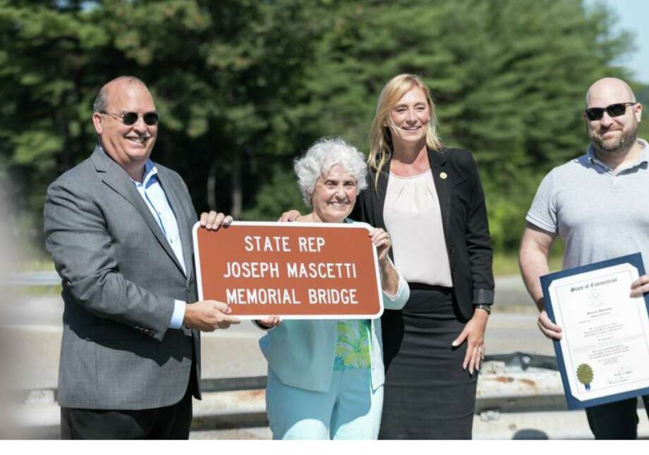 State Rep. Michelle Cook, third from left, joined members of the Mascetti family Tuesday to dedicate the bridge on Route 118 overpassing Route 8 in Harwinton, in memory of late State Representative Joseph Mascetti, who was elected to the Connecticut General Assembly in 1920. From left are William Mascetti, Joseph Mascetti's grandson, Anne Mascetti Conboy, Joseph Mascetti's granddaughter, Cook, and Garrett Eucalitto, Joseph Mascetti's great-great grandson. Photo: Contributed Photo /
