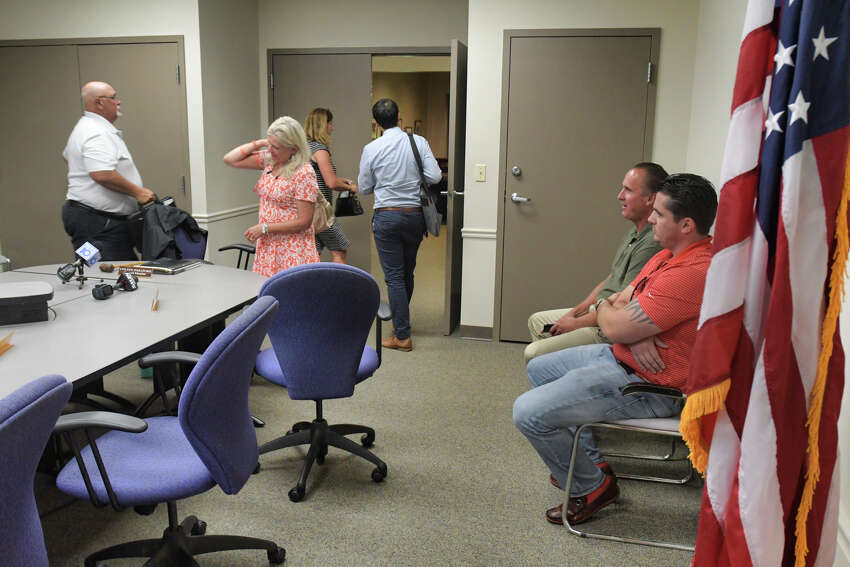 Troy City Council Law Committee members, Jim Gulli, left, and committee chair, Coleen Paratore, second from left, leave the room where the law committee was meeting to go into executive session in another room on Wednesday, Sept. 4, 2019, in Troy, N.Y. The committee went into executive session to discuss the report by Michael Ranalli on the findings of the Troy Police Department's Internal Affairs investigation of the Thevenin shooting. Troy Police Benevolent and Protective Association President, Officer Nick Laviano, right, and PBA Vice President, Detective Mark Millington, look on. (Paul Buckowski/Times Union)