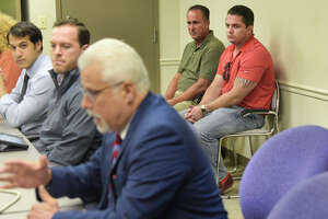 Troy Police Benevolent and Protective Association Vice President, Detective Mark Millington, background left, and PBA President, Officer Nick Laviano, look on as James Caruso, foreground, Troy City attorney, calls for the meeting of the Troy City Council Law Committee to go into executive session on Wednesday, Sept. 4, 2019, in Troy, N.Y. The committee did go into executive session to discuss the report by Michael Ranalli on the findings of the Troy Police Department's Internal Affairs investigation of the Thevenin shooting.     (Paul Buckowski/Times Union)
