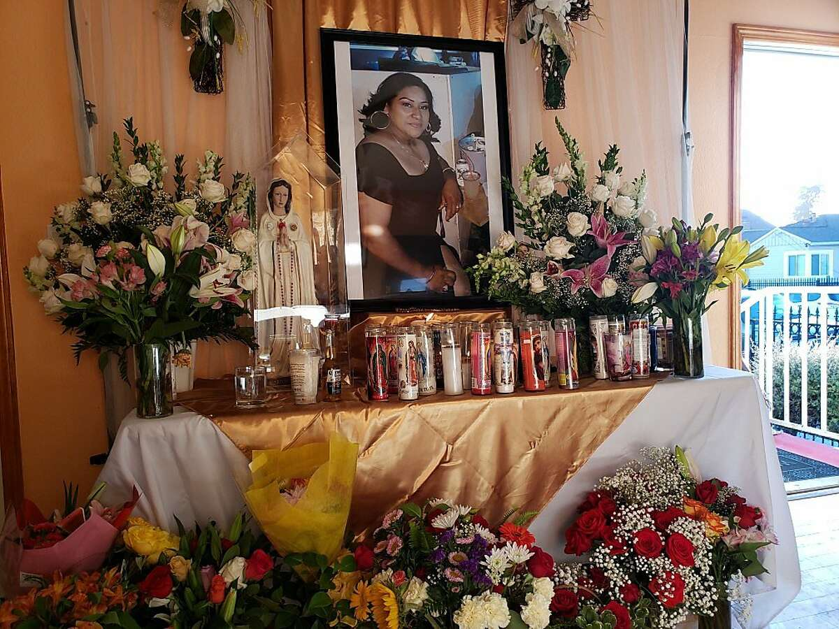 Family and friends of Martha Casiano attended a prayer Tuesday afternoon, where a portrait of Casiano was surrounded by flowers and candles.