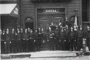 Members of San Francisco's Eureka Fire Company pose in their uniforms in front of their firehouse on Mason between Post and Sutter. San Francisco's volunteer firemen put great effort into their uniforms, and they wore them in parades.   Photo:  OpenSFHistory