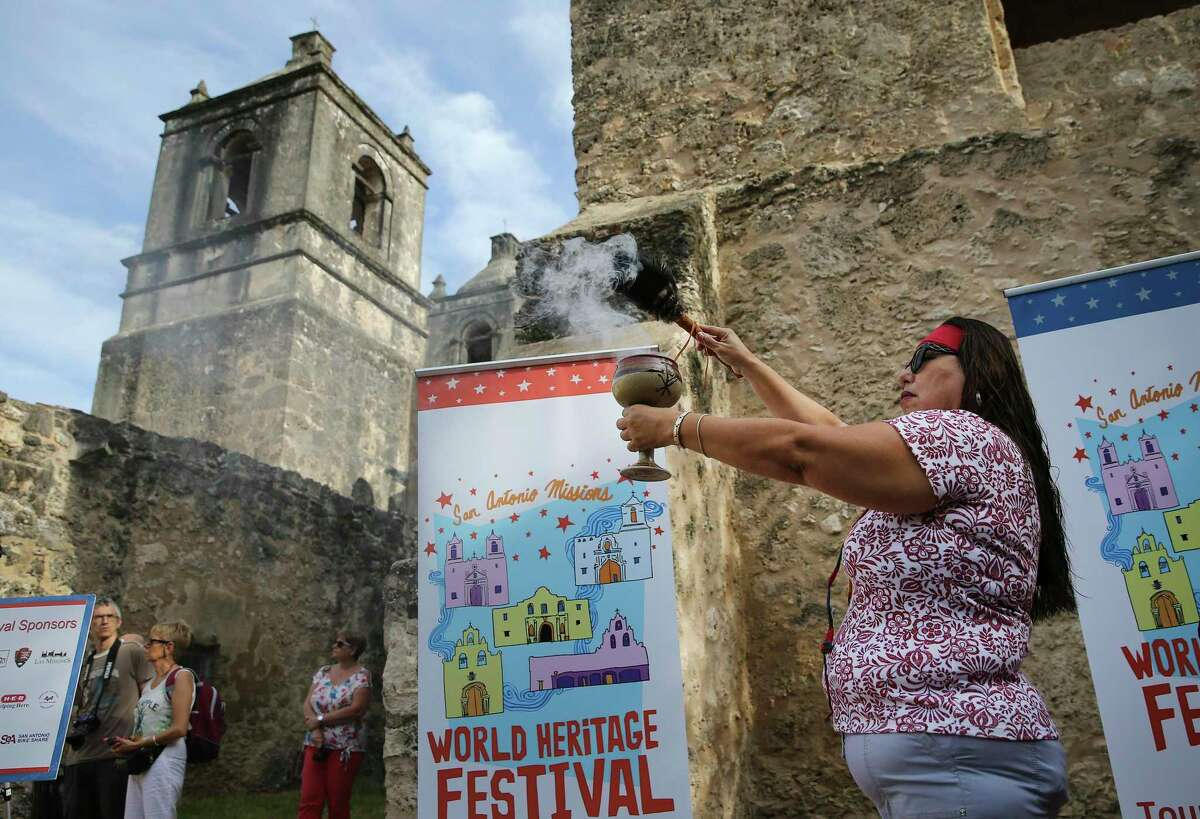 Melba Osio of the Tehuan Band of Mission Indians of San Antonio performs an indigenous blessing as local and national parks officials kick off the 4th annual World Heritage Festival with a press conference at Mission Concepcion on Wednesday, Sept. 4, 2019. A series of events highlighting the San Antonio Missions runs through Sunday, including the public release of a commemorate quarter, an outdoor movie screening, a house-rehabilitation project, a bike ride and a pachanga or party on Saturday and a mariachi mass and procession from Mission Espada to Mission San Juan wrapping up on Sunday. (Kin Man Hui/San Antonio Express-News)