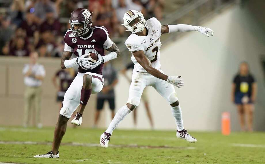 Texas A&M defensive back Myles Jones (10) intercepts a pass intended for Texas State wide receiver Jeremiah Haydel (3) during the first half of an NCAA college football game Thursday, Aug. 29, 2019, in College Station, Texas. (AP Photo/Sam Craft) Photo: Sam Craft, FRE / Associated Press / AP