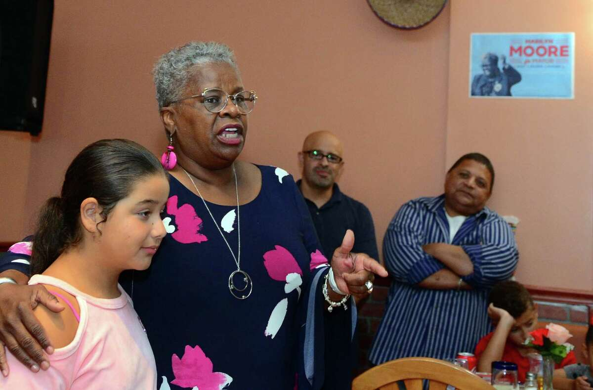 State Senator Marilyn Moore, who is running for mayor, speaks to supporters during a fundraiser at Coyote Flaco restaurant in Bridgeport, Conn., on Tuesday August 27, 2019. Standing with Moore is Jayda Marin, 11.