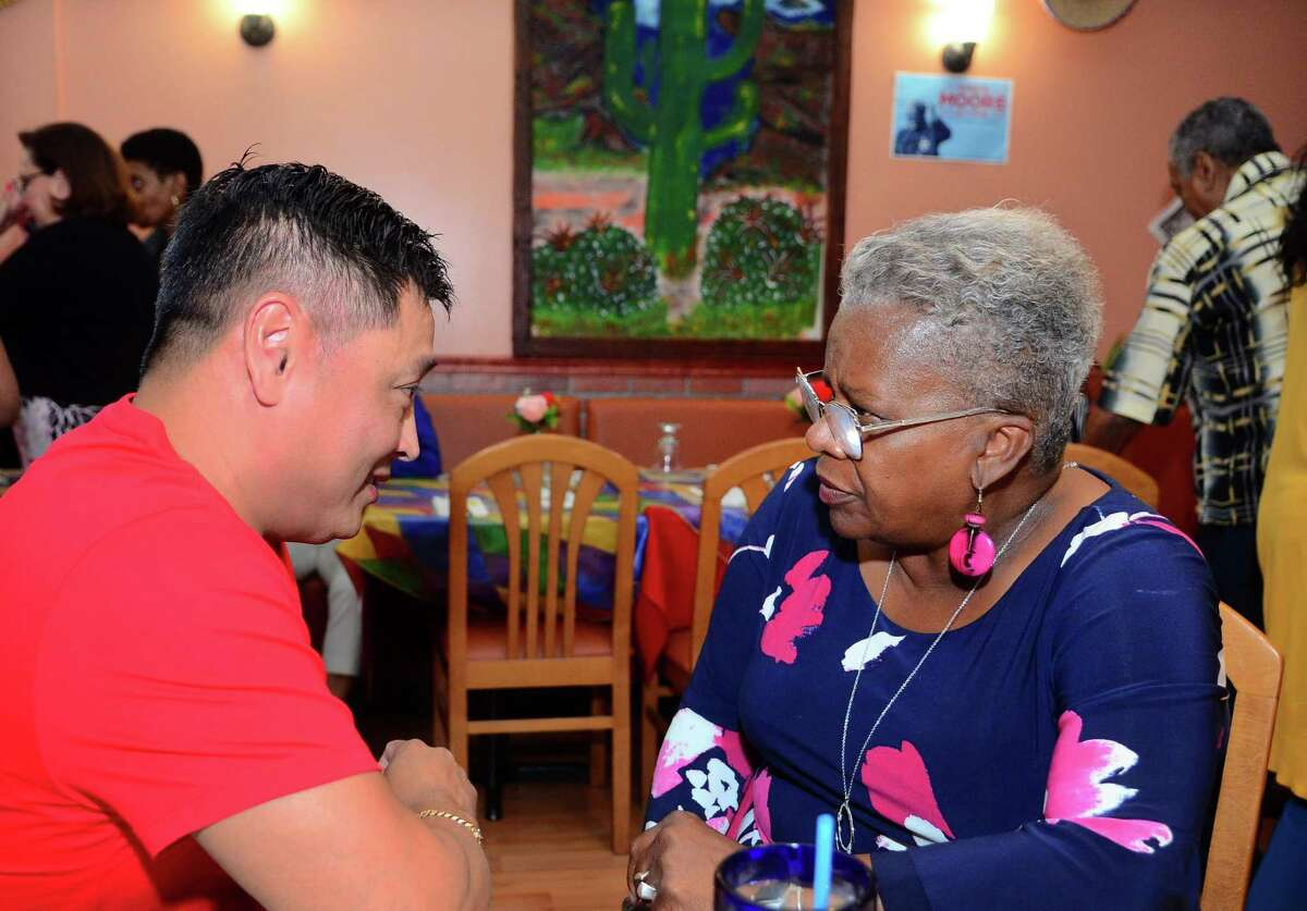 State Senator Marilyn Moore, who is running for mayor, listens to the concerns of voter Hung Ngo during a fundraiser at Coyote Flaco restaurant in Bridgeport, Conn., on Tuesday August 27, 2019.