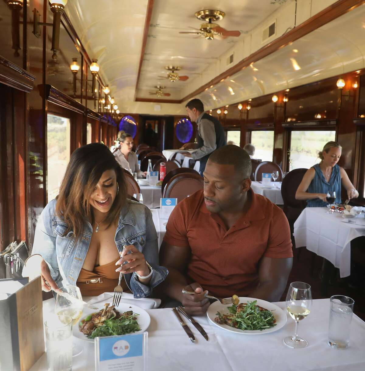 Clarissa Woods (left) from Monterey and Demetric Antonio (middle) from San Diego have lunch on the Napa Valley Wine Train, which is celebrating its 30th anniversary on Sept. 16 seen on Friday, Aug. 30, 2019 in Napa, Calif.