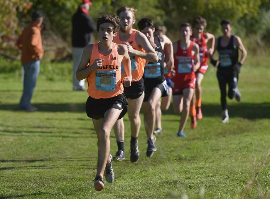 Chuckie Namiot, front, and Ethan MacKenzie, behind Namiot, are the top returning runners for the Ridgefield boys cross country team. Photo: Dave Stewart / Hearst Connecticut Media