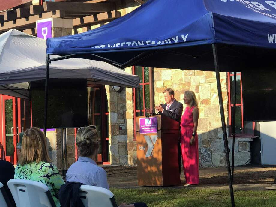 John and Kristin McKinney, Generations STart Here Capital Campaign co-chairs, spoke before a gathered crowd about the history of the Wesport-Weston YMCA. Taken Sept. 3, 2019 in Westport, CT. Photo: Lynandro Simmons/Hearst Connecticut Media