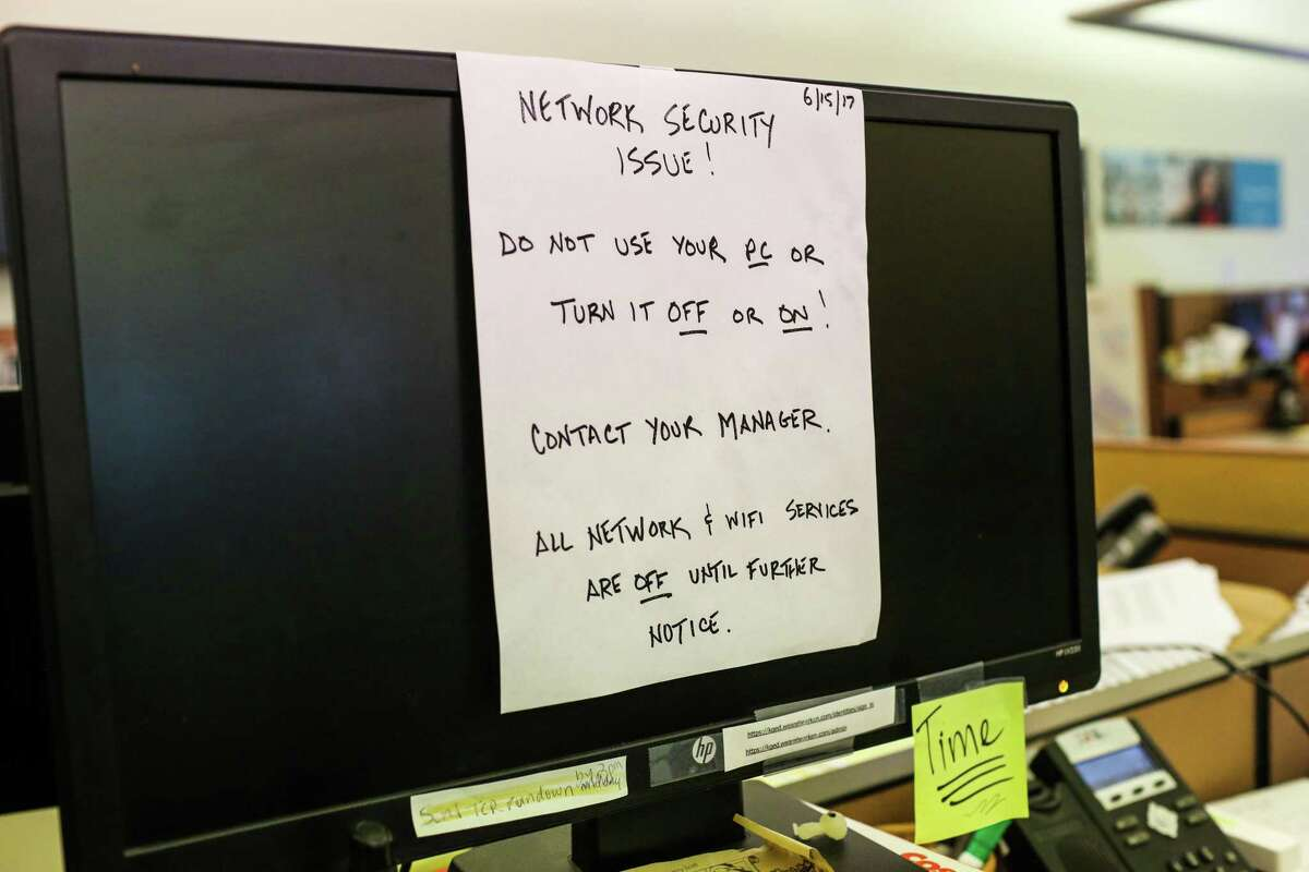 A note is seen on a computer addressing the ransomware attack that infected KQED's internal operations at KQED in San Francisco, Calif., on Monday, July 17, 2017.