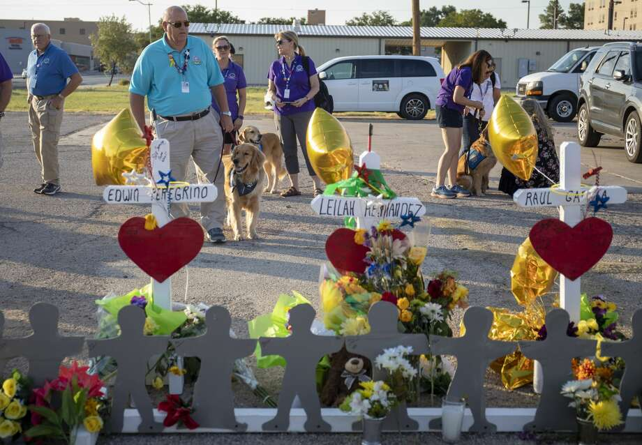 Comfort dogs were available to the public Tuesday, Sept. 3, 2019, at 2nd St. and Sam Houston in Odessa, Texas.  Jacy Lewis/Reporter-Telegram Photo: Jacy Lewis/ Midland Reporter-Telegram Reporter-Telegram