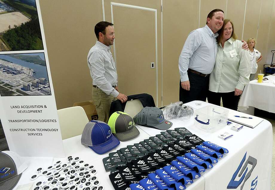 Fire-S Group's Brandon Ashley greets Stacie Clark as he and co-worker Brandon Soileau work their booth during the Golden Pass LNG forum held at the Bob Bowers Civic Center in Port Arthur Tuesday. Area vendors, contractors and other business were invited to learn more about the Golden Pass LNG export project.  Photo taken Tuesday, June 18, 2019  Kim Brent/The Enterprise Photo: Kim Brent / The Enterprise / BEN