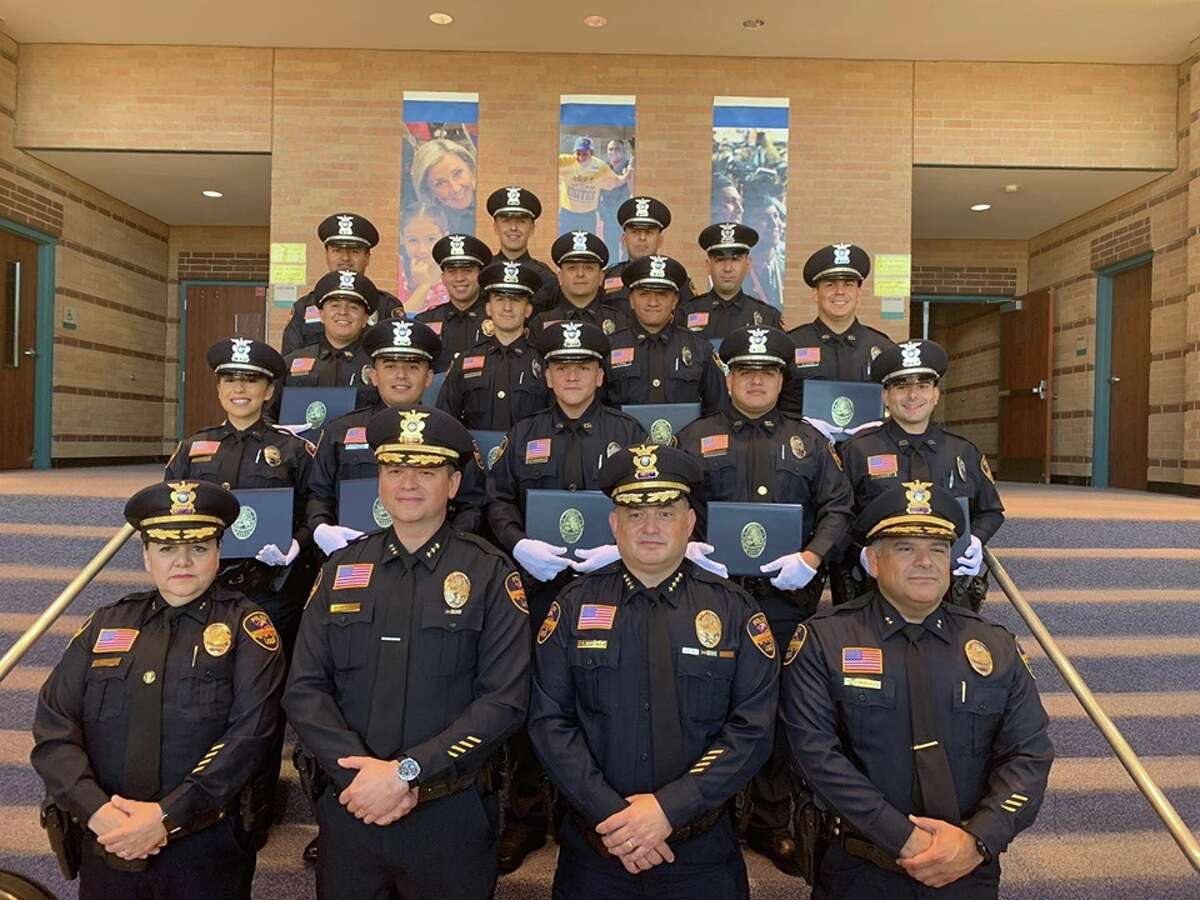 Laredo police recently welcomed 15 officers into the blue family during a pinning of the badge ceremony. LPD chiefs are seen with the new cops in this photo.