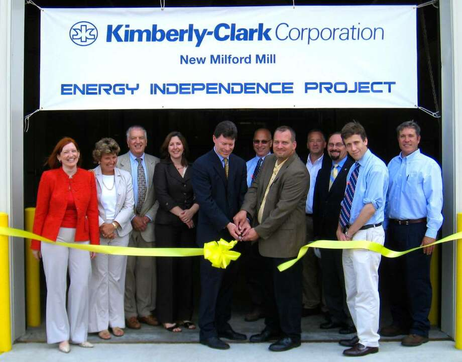 SPECTRUM/State Sen. Fonfara (D-1st), left, of Hartford and Kimberly-Clark energy manager Chuck Smith do the honors at a ribbon-cutting ceremony Thursday, July, 2010 for the Kimberly-Clark Corporation's energy independence project in New Milford. Sen. Fonfara has been a leading proponent of such projects in the state while Mr. Smith was the project leader at the New Milford mill during the facility's creation and construction. Also on hand for the occasion are, from left to right, Kimberly-Clark's attorney on the project,Susan Bruce of McNees, Wallace & Nurick; Jean Cronin of Hughes & Cronin Public Affairs Strategies; State Rep. Larry Miller (R-122nd); Peggy Diaz of the state Department of Public Utility Control; State Rep. Clark Chapin (R-67th) of New Milford; Jim Schneider, Kimberly-Clark's energy supply manager; Vin Nolan, the Economic Development supervisor for New Milford; State Rep. Matt Loesser (D-100th); and mill manager Dan Lachmann. Photo: Norm Cummings / The News-Times