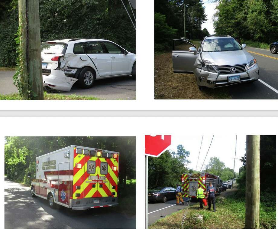 Ridgefield firefighters and medics arrive at the scene of a car accident at the intersection of Ashbee Lane and Route 7 on Aug. 29. Neighbors have petition the state's Department of Transportation for improved safety measures at the intersection. Photo: James Russell / Contributed Photo