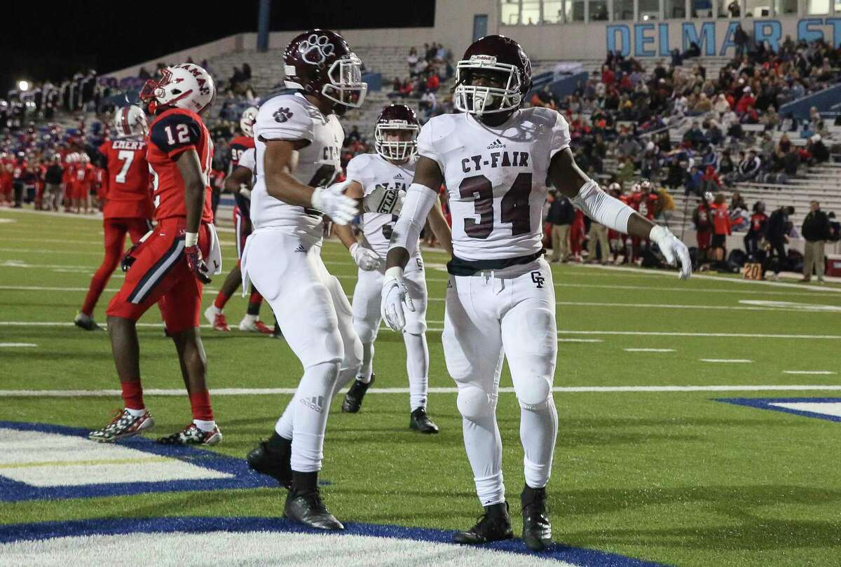 Cy-Fair running back L.J. Johnson (34) scores a touchdown during the third quarter of the playoff game at the Delmar Stadium on Friday, Nov. 16, 2018, in Houston.
